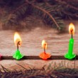 Christmas candles on wooden background — Stock Photo