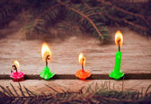 Christmas candles on wooden background — Stockfoto