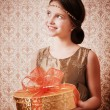 Happy girl with gift — Stockfoto