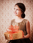 Happy girl with gift — Stock Photo