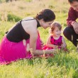 Happy mother, father and daughter outdoor — ストック写真