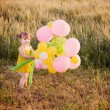 Girl with balloons outdoor — 图库照片