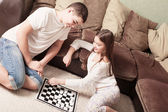 Children with draughts at home — Foto Stock