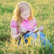 Little girl reading book — Stock Photo #37061275