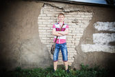 Young man standing next to a wall outdoors — Stock Photo