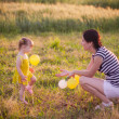 Mother with little girl playing outdoor — Stock Photo