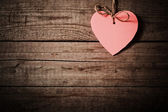 Pink heart made of paper on wooden background — Stock Photo