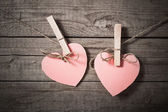 Two hearts on wooden background — Stock fotografie