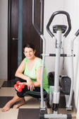 Mature women on trainer machines at home — Stock Photo