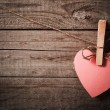 Pink heart made of paper on wooden background — Stock Photo #37631991