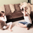 Stock Photo: Childrens fighting with pillows