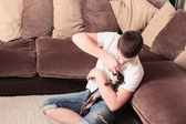 Teenager with dog at home — Stock Photo