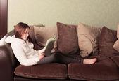 Pre-teen girl reading a book — Stock Photo