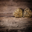 Golden Heart Over Wooden Background — Stock Photo