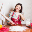 Stock Photo: Beautiful girl cooking cake in kitchen