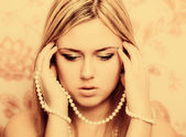 Beautifu blonde woman with pearl beads — Stock Photo