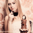 Portrait of beautiful girl with cup of coffee and chocolate can — Stock Photo
