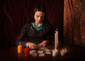Young woman with divination cards in room — Stock Photo