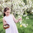 Girl Holding Basket Of Decorated Eggs — Stock Photo