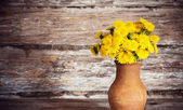 Dandelions on wooden background — Stock Photo