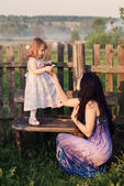 Mother and little girl in garden — Stock Photo