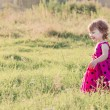 Little girl playing in a field — Stock Photo #40914575