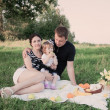 Happy mother, father and daughter outdoor — Stock Photo
