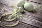 Green easter eggs  on wooden background — Stock Photo