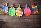 Child's drawing of Easter eggs on wooden background — Stock Photo