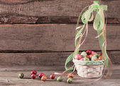 easter eggs in  basket on wooden background — Stock Photo
