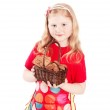 Beautiful little girl holding cookies isolated on white — Stock Photo