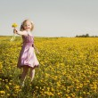 Happy girl with dandelion outdoor — Stock Photo