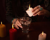 Divination with candle — Stock Photo