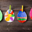 Child's drawing of Easter eggs on wooden background — Stock Photo #43292265