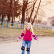 Happy girl in roller skates — Stock Photo