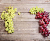 Grapes on a wooden table — Stock Photo