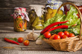 Preserved  and fresh vegetables on wooden background — Stock Photo