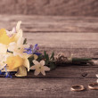 Wedding bouquet with rings on wooden background — Stock Photo #44726085