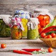 Preserved and fresh vegetables on wooden background — Stock Photo #45067531