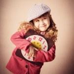 Happyl child holding old clock — Stock Photo #45725355