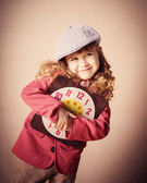 Happyl child holding old clock — Stock Photo