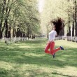 Beautiful girl  jumping in park — Stock Photo #45931589