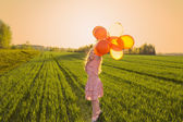 Girl with balloons outdoor — Stock Photo