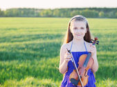 Beautiful girl with violin outdoor — Stock Photo