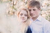 Portrait of young couple in spring gadren — Stock Photo