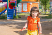 Happy child on playground — Stock Photo