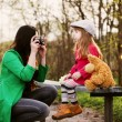 Mother photographing her child outdoor — Stock Photo #47445557