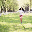 Beautiful girl jumping in park — Stock Photo #47444629