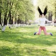 Beautiful girl jumping in park — Stock Photo #47445867