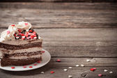 Cake with hearts on wooden background — Zdjęcie stockowe